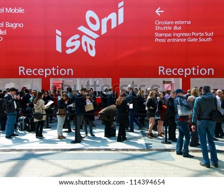 MILAN - APRIL 17: People  enter interior design pavilions at Salone del Mobile, international furnishing accessories exhibition on April 17, 2012 in Milan, Italy. - stock photo