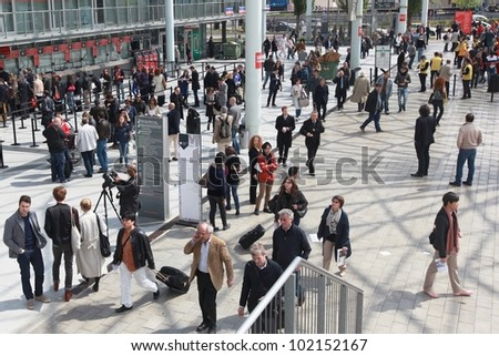 MILAN - APRIL 17: People entering Salone del Mobile, international furnishing accessories exhibition on April 17, 2012 in Milan, Italy.