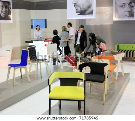 MILAN - APRIL 15: People look at home interior design and decoration stands during Salone del Mobile, international furnishing accessories showcase April 15, 2010 in Milan, Italy.