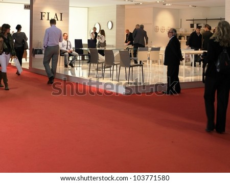 MILAN - APRIL 13: People look at interior design solutions during Salone del Mobile, international furnishing accessories exhibition on April 13, 2011 in Milan, Italy.