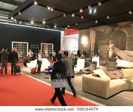 MILAN - APRIL 13: People look at interiors design and home architecture solutions during Salone del Mobile, international furnishing accessories exhibition on April 13, 2011 in Milan, Italy.