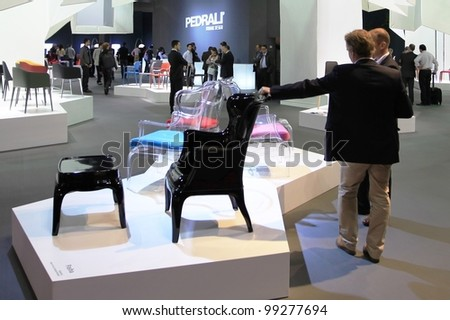 MILAN - APRIL 13: People look at interiors design solutions at Salone del Mobile, international furnishing accessories exhibition on April 13, 2011 in Milan, Italy.