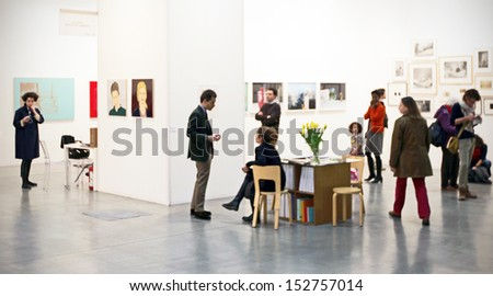 MILAN - APRIL 07: People look at paintings gallery at MiArt, international exhibition of modern and contemporary art April 07, 2013 in Milan, Italy. - stock photo