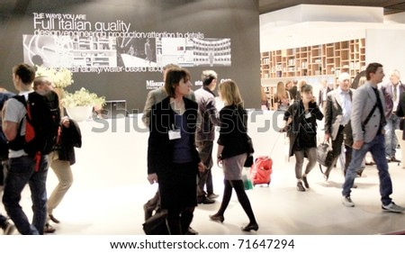 MILAN - APRIL 15: People looking at home interior design and decoration stands during the Salone del Mobile international furnishing accessories exhibition April 15, 2010 in Milan, Italy.