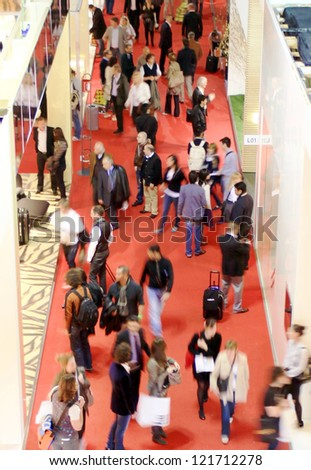 MILAN - APRIL 15: People visit interior design exhibition area at Salone del Mobile, international furnishing accessories exhibition April 15, 2010 in Milan, Italy. - stock photo