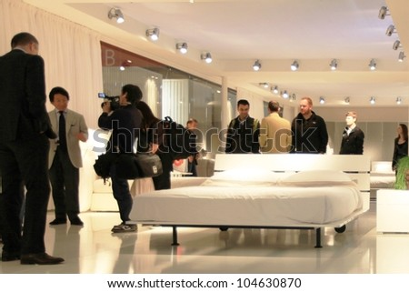 MILAN - APRIL 13: People visit interior design solutions area during Salone del Mobile, international furnishing accessories exhibition on April 13, 2011 in Milan, Italy.