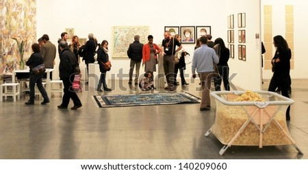 MILAN - APRIL 07: People visit paintings galleries at MiArt, international exhibition of modern and contemporary art April 07, 2013 in Milan, Italy.