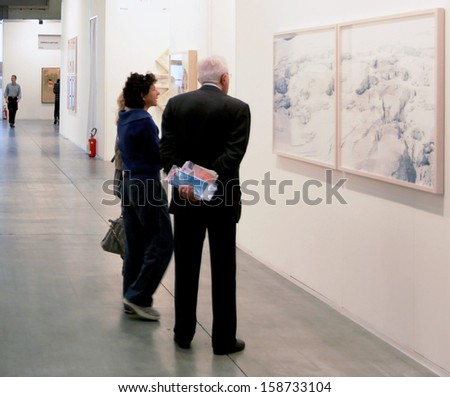 MILAN - APRIL 08: People walk trough painting galleries at MiArt, international exhibition of modern and contemporary art on April 08, 2011 in Milan, Italy - stock photo