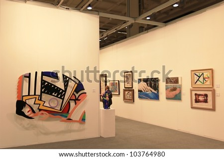 MILAN - APRIL 08: Visiting paintings and sculpture work of arts galleries during MiArt, international exhibition of modern and contemporary art on April 08, 2011 in Milan, Italy. - stock photo