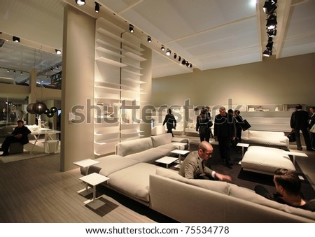 MILAN - APRIL 13: Visitors look at interiors design solutions stands during Salone del Mobile, international furnishing accessories exhibition on April 13, 2011 in Milan, Italy.