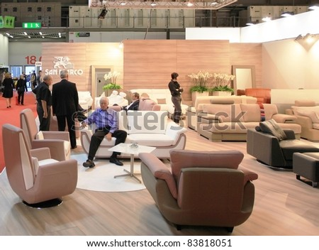 MILAN - APRIL 13:Visitors look at interiors design stands and home architecture solutions visiting Salone del Mobile, international furnishing accessories exhibition on April 13, 2011 in Milan, Italy.