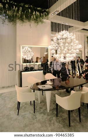 MILAN - APRIL 13:Visitors look at interiors design stands and home architecture solutions visiting Salone del Mobile, international furnishing accessories exhibition on April 13, 2011 in Milan, Italy. - stock photo