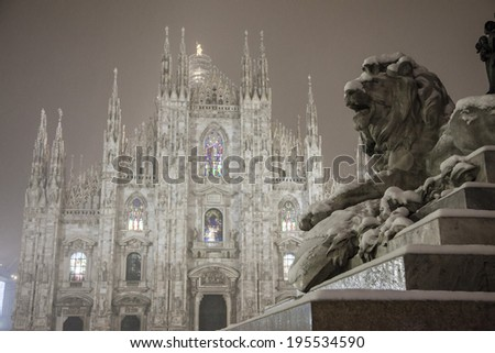 Milan Cathedral and monument night, in winter with snow - stock photo