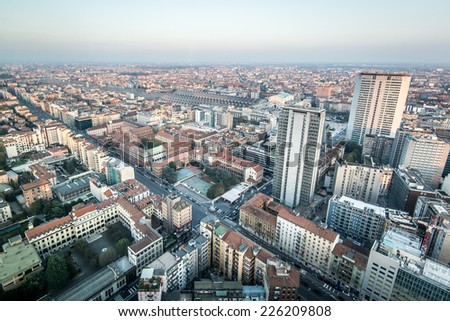 Milan cityscape from the viewpoint at 39st of Regione Lombardia skyscraper,  skyscrapers and Central Station. - stock photo