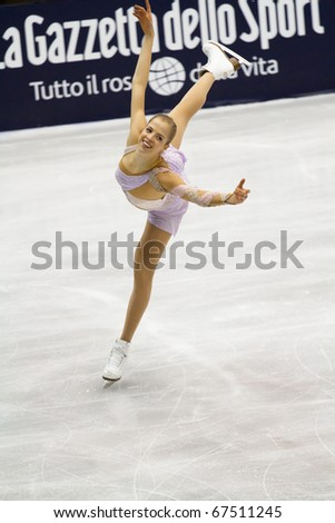 MILAN - DEC 18: Carolina Kostner during the Italian Championship in the Forum Arena, on December, 2010, in Milan. She win the gold medal - stock photo