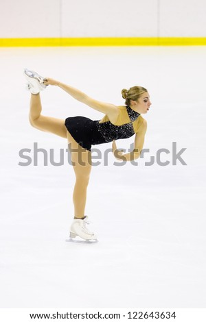 MILAN-DECEMBER 22:  Elena Vanz perform in Italian Championships of Figure Skating 2012 on December 22 , 2012 in Milan, Italy - stock photo