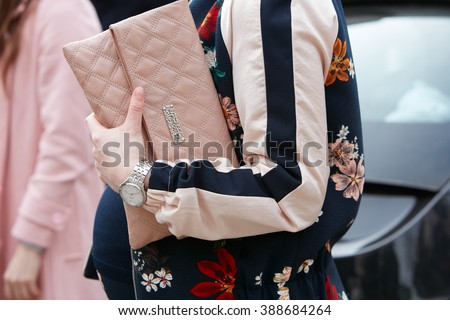 MILAN - FEBRUARY 24: Woman poses for photographers with Marc Jacobs pink bag and floral jacket before Gucci fashion show, Milan Fashion Week Day 1 street style on February 24, 2016 in Milan. - stock photo
