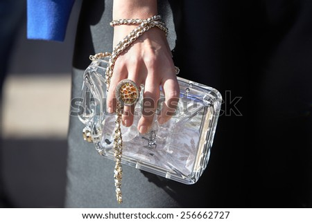 MILAN - FEBRUARY 25: Woman with crystal transparent bag before Stella Jean show Milan Fashion Week Day 1, Fall/Winter 2015/2016 street style day 1, on February 25, 2015 in Milan.