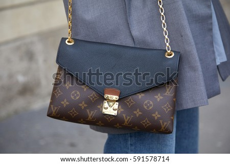 louis vuitton 2017 bags. milan - february 24: woman with louis vuitton bag before tod\u0027s fashion show, milan 2017 bags