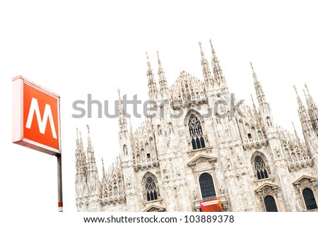 Milan Gothic Cathedral Dome Landmark and a Metro Underground Signal isolated under a white sky. Italy, Europe. - stock photo