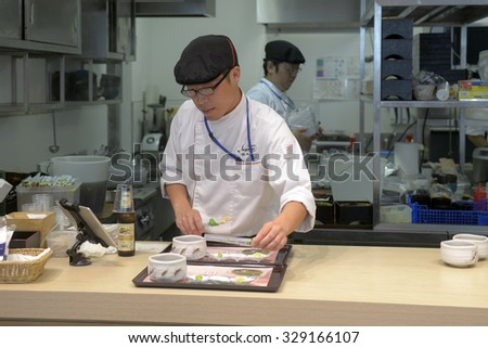 MILAN,I TALY-OCTOBER 07, 2015: preparing japanese food at the Japan's pavillion restaurant at EXPO2015, in Milan.