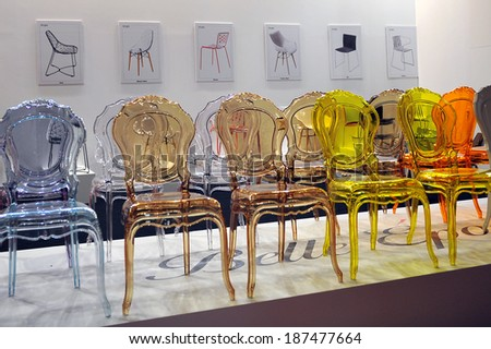 MILAN, ITALY - APR 9: Chairs transparent at Salone del Mobile, international furnishing accessories exhibition in Milan, Italy- April 9, 2014   - stock photo