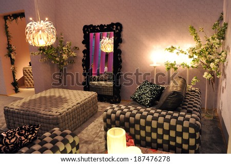 MILAN, ITALY - APR 9 :Living room at Salone del Mobile, international furnishing accessories exhibition in Milan, Italy- April 9, 2014  - stock photo