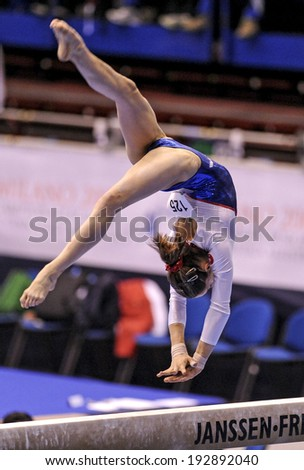 MILAN, ITALY-APRIL 02, 2009: a female gymnast playing beam exercise, during the European Artistic Gymnastic Championship, in Milan.