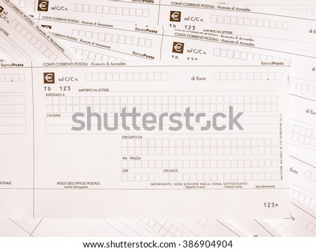 MILAN, ITALY - APRIL 2, 2015: Blank Italian postal order forms for payments, aka as Bollettino Postale in Italy, vintage