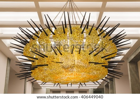 MILAN, ITALY - APRIL 15: Chandelier on display at Fuorisalone, set of events distributed in different areas of the town during Milan Design Week on APRIL 15, 2016 in Milan. - stock photo