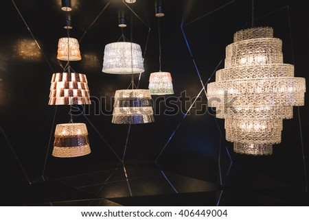 MILAN, ITALY - APRIL 15: Chandeliers on display at Fuorisalone, set of events distributed in different areas of the town during Milan Design Week on APRIL 15, 2016 in Milan. - stock photo