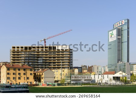 MILAN, ITALY - APRIL 11: cityscape and Regione building with EXPO advertising prospecting on the wheat field prepared for international fair in city center, shot  on april 11 2015  Milan, Italy  - stock photo