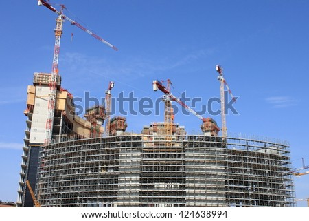 MILAN, ITALY - APRIL 10: Construction of skyscrapers in Porta Nuova district on April 10, 2010 in Milan, Italy. This complex of eco-friendly buildings was designed by the architect Clarke Pelli - stock photo