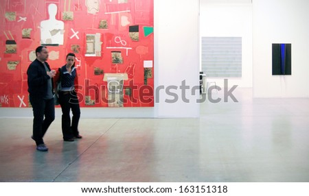 MILAN, ITALY - APRIL 08: Couple looking at paintings galleries during MiArt, international exhibition of modern and contemporary art on April 08, 2011 in Milan, Italy  - stock photo