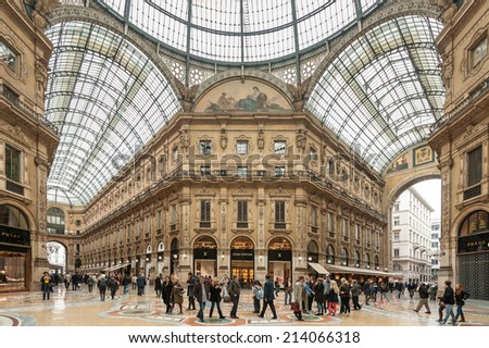MILAN, ITALY - APRIL 11 : Galleria Vittorio Emanuele II on April 11, 2013 in Milan. It's one of the world's oldest shopping malls, designed and built by Giuseppe Mengoni between 1865 and 1877 - stock photo
