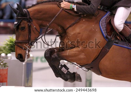 MILAN, ITALY- APRIL 22, 2004: horse jumping fence during a dressage horse riding event, in Milan - stock photo