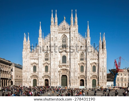 MILAN, ITALY - APRIL 7 2015: Magnificent Milan's Duomo will receive renewed attention throughout Milano Expo 2015 as 29 million people from 154 countries are expected to visit the city.