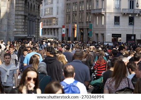 MILAN , ITALY - 10 April 2015: many people are walking to the city center on a spring day. It is customary on nice days to crowd the center for shopping - stock photo