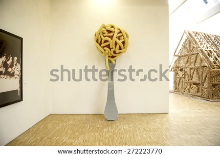 MILAN, ITALY-APRIL 17, 2015: modern art displayed during the Arts and Foods exhibition at the architecture, design and arts museum La Triennale, in Milan. - stock photo