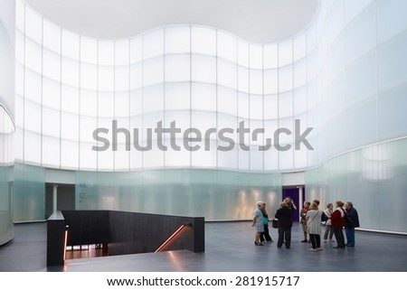 MILAN, ITALY - APRIL 15: Mudec, Museo delle Culture, ethnographic museum interior with people during Milan design week on April 15, 2015 in Milan.