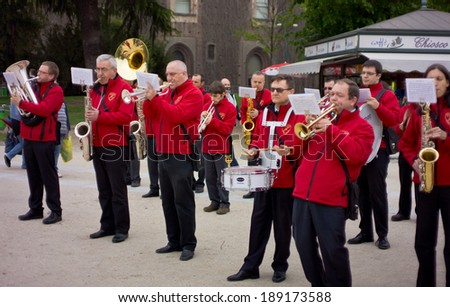 MILAN, ITALY - APRIL, 12, 2012 : Parade of brass bands at Castello Sforzesco in Milan, Italy on April, 12, 2012. Brass bands have along tradition of competition between bands. - stock photo