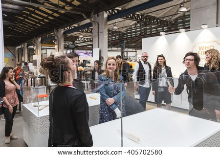 MILAN, ITALY - APRIL 12: People visit Fuorisalone at Ventura Lambrate space, location of important events during Milan Design Week on APRIL 12, 2016 in Milan. - stock photo