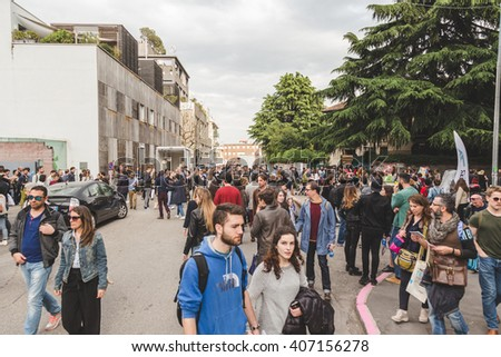 MILAN, ITALY - APRIL 16: People visit Fuorisalone, set of events distributed in different areas of the town during Milan Design Week on APRIL 16, 2016 in Milan. - stock photo