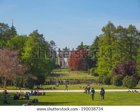 MILAN, ITALY - APRIL 10, 2014: People visiting the Parco Sempione large central park - stock photo