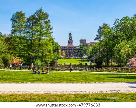MILAN, ITALY - APRIL 10, 2014: People visiting the Parco Sempione large central park (HDR)