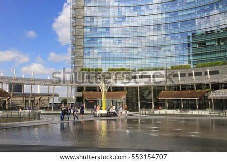 Milan, Italy - April 18, 2016: Piazza Gae Aulenti in Milan is a modern square surrounded by buildings and skyscrapers, it is the business district of the city.
