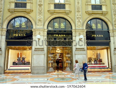 MILAN, ITALY - APRIL 12, 2014: Prada store in Galleria Vittorio Emanuele II in Milan, one of the world's oldest shopping malls, built between 1865 and 1877. - stock photo