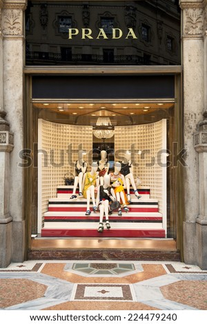 MILAN, ITALY - APRIL 18, 2014: Prada store in one of the world's oldest shopping mall Galleria Vittorio Emanuele II. Prada is a luxury leather and fashion company, founded in 1913 by Mario Prada. - stock photo