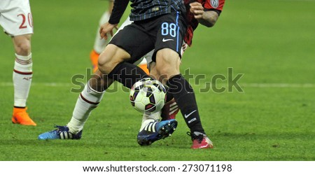 MILAN, ITALY-APRIL 19, 2015: soccer players close up in action during the soccer milanese derby FC Internazionale vs AC Milan, at the san siro soccer stadium, in Milan.