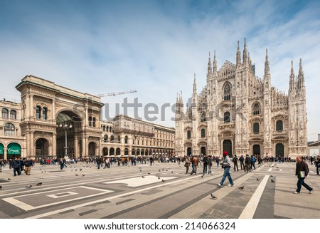 MILAN, ITALY - APRIL 10, 2013: Tourists visiting the Piazza Duomo square in Milan Italy - stock photo